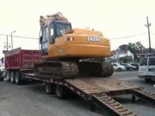 Loading Deere 120c