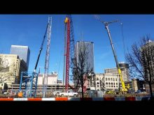 Maxims gmk 7550 erecting tower cranes at louisville omni hotel