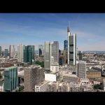 Scanclimber SC8000 mast climber cladding the 148 m Eurotower skyscraper in Frankfurt, Germany