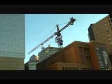 timelapse of a tower crane taking out its own tower sections